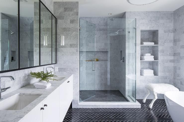 Marble Clad Modern Bathroom Features A White Flat Front Dual