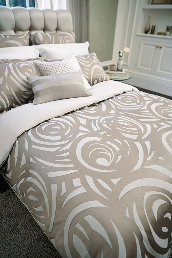 vortex king size duvet the king size duvet cover has a stylish combination of taupe and pebble colour silhouettes of overlapping swirls with a plain