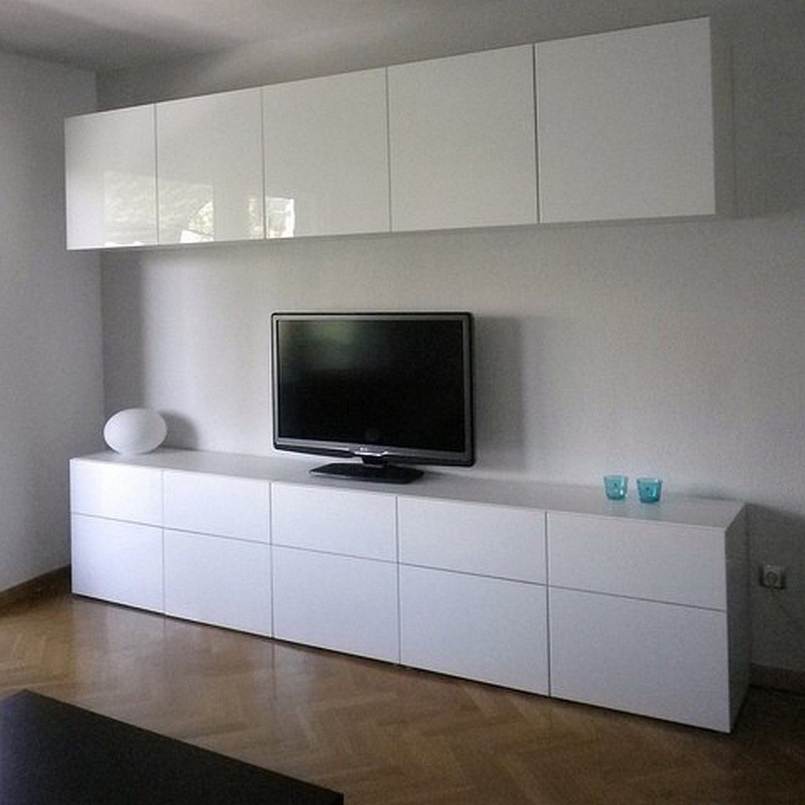 ikea besta cabinets with high gloss doors in living room. Black Bedroom Furniture Sets. Home Design Ideas