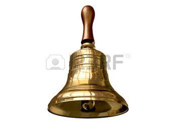 Una scuola campana metallo oro regolare con un manico di legno su uno sfondo bianco isolato photo