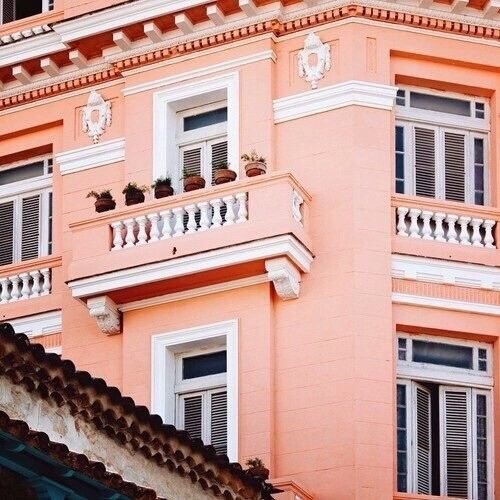 Blending muted tones with fun pops of more vibrant colors to create a unique pastel aesthetic. peachy   Building aesthetic, Orange aesthetic, Peach aesthetic