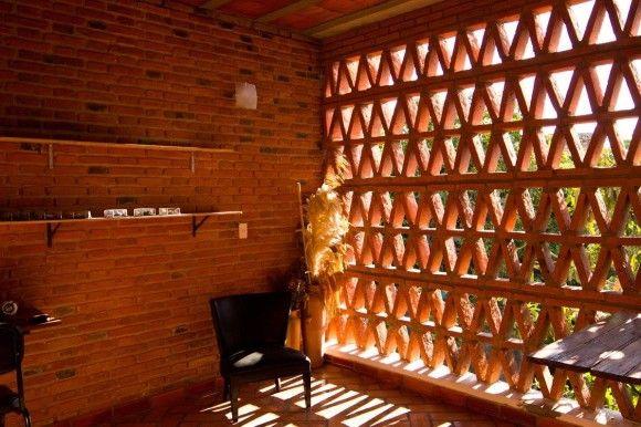 Parasol double skin brickwork green rooms interior