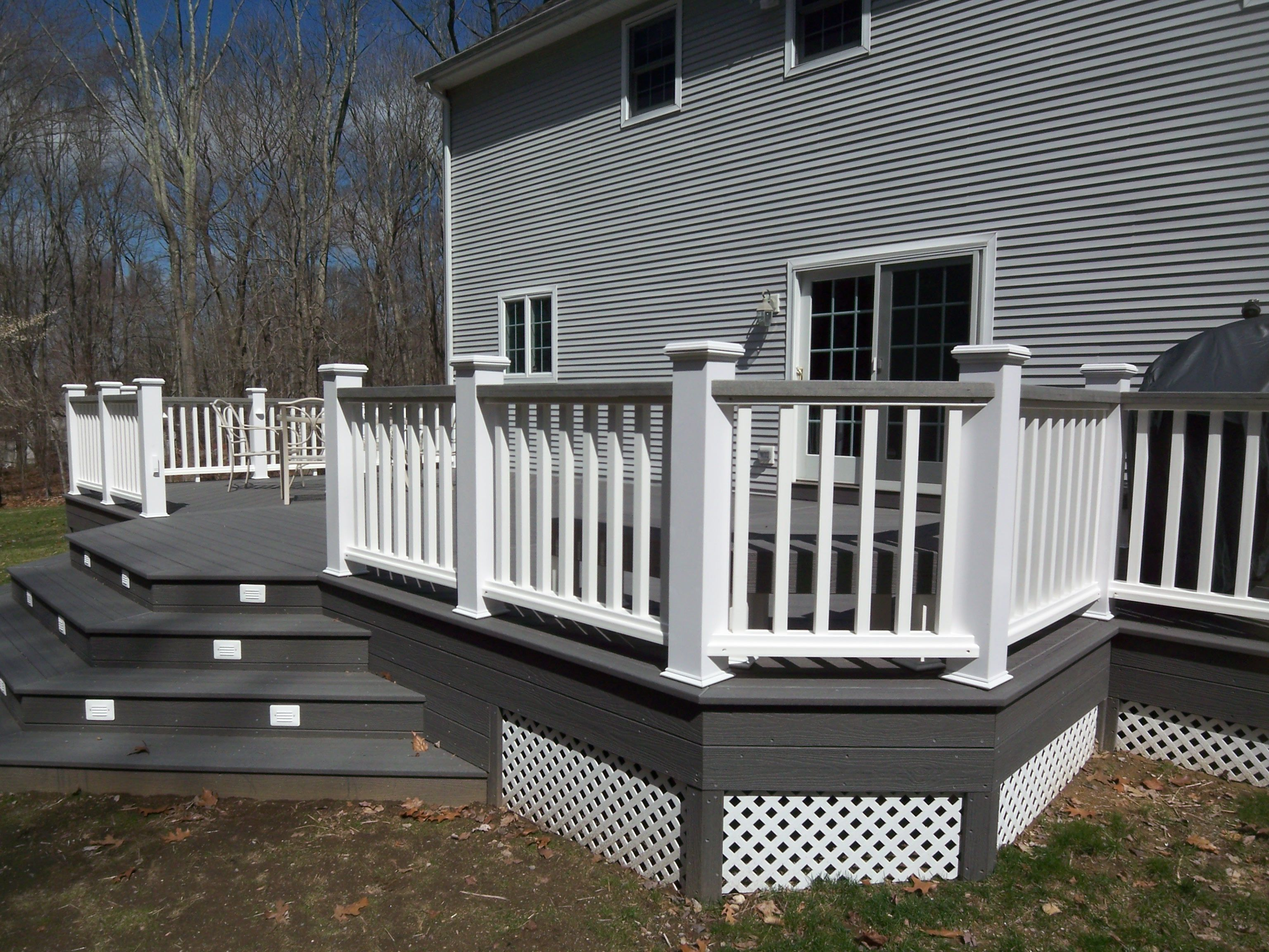 White and gray wood porch composite decks hot tub decks for Outdoor composite decking