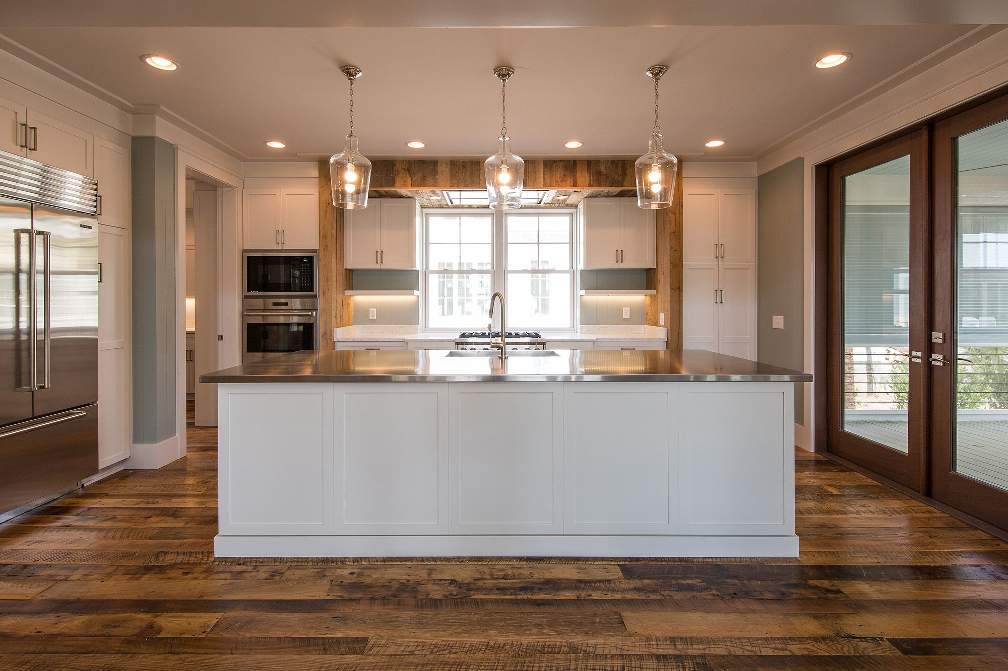 Spacious White Kitchen | Trendy Kitchen Lighting | Luxury Real Estate  Bluffton, South Carolina |