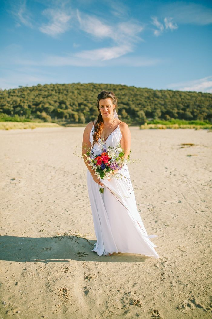 Bride in her custom made wedding dress + colourful bouquet | itakeyou.co.uk