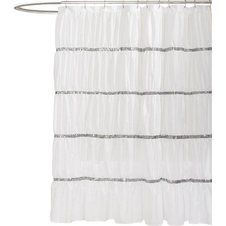 Glittering with stripes of silver sequins, this softly ruched shower curtain lends a glamorous feel to your master bath or powder room.