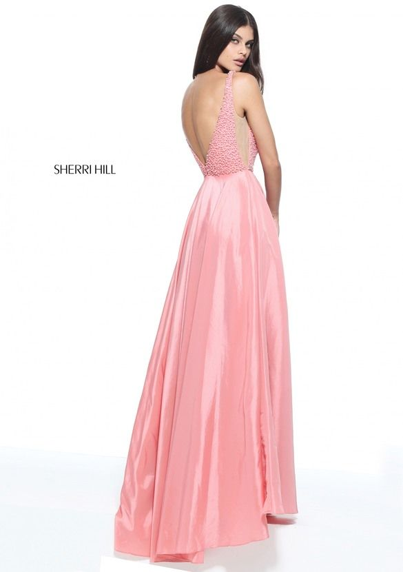 V-neck taffeta a-line gown with a pearl encrusted bodice and sheer sides.