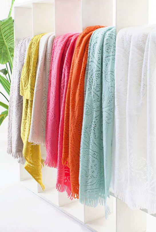 Crafted of machine-washable acrylic in a unique lace pattern, this cozy throw is full of personality and retro charm. Available in a variety of juicy brights and versatile neutrals.