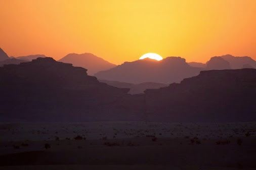 Pic of the Day: Glowing sky at sundown over the mountains of Wadi Rum, Jordan.