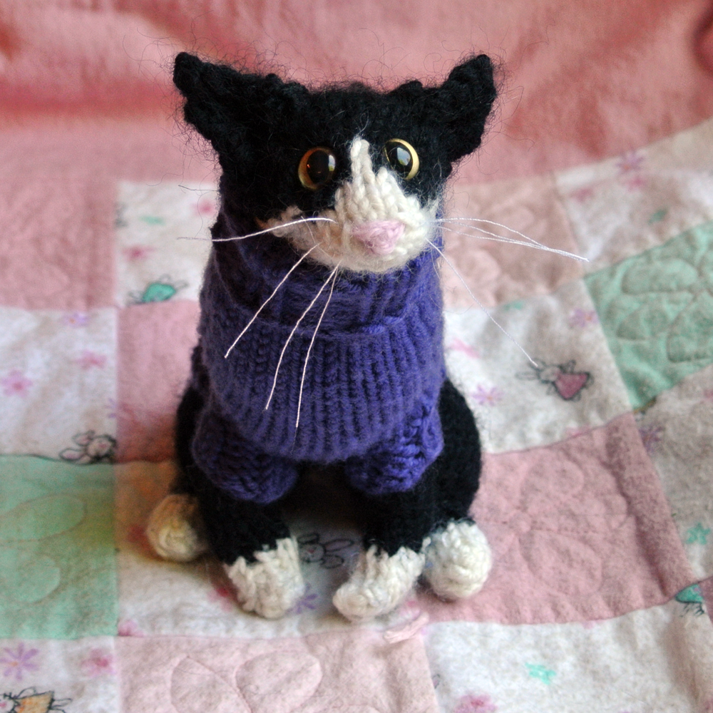 knitted black and white cat in a purple sweater | Chromatics ...