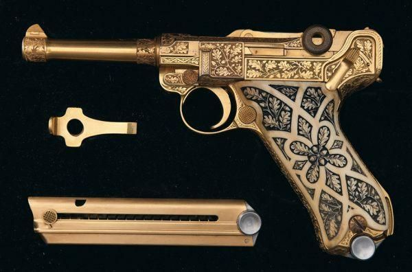 exceptionally rare gold plated, factory engraved Luger