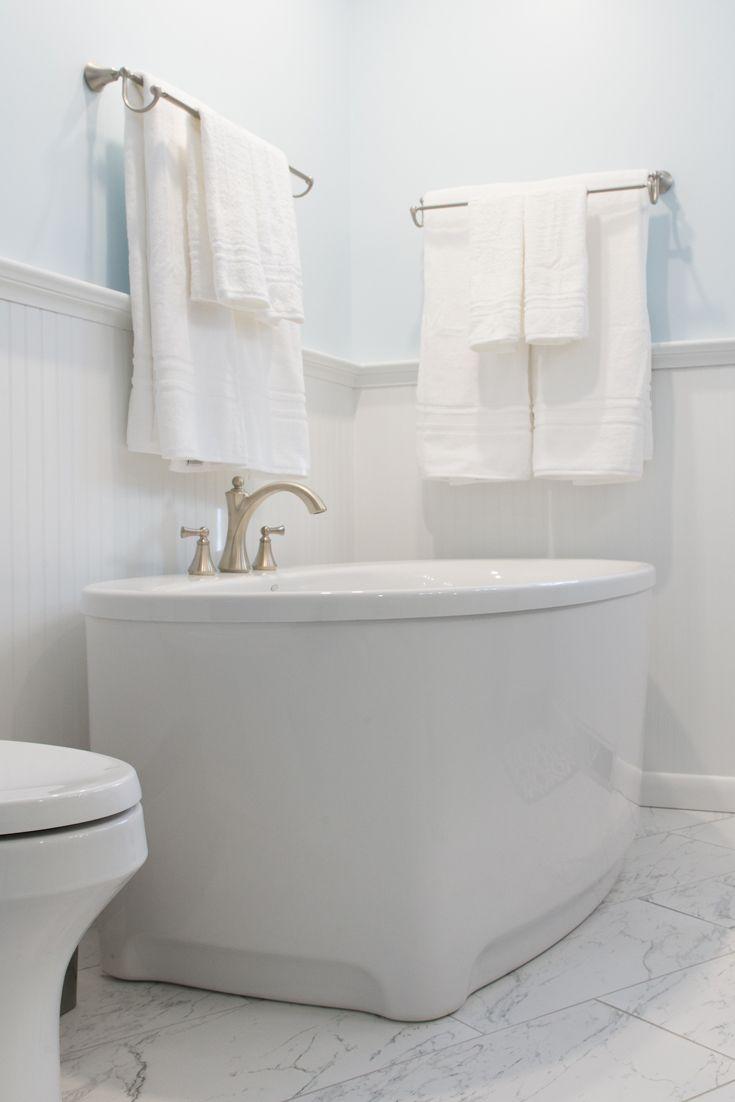 Kohler Underscore Oval freestanding tub. Deep enough to soak the day ...