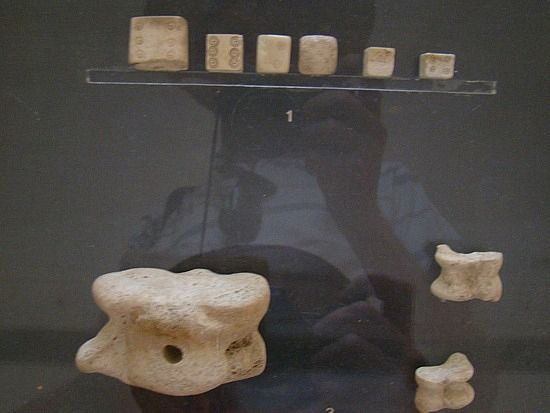 Dice from Pompeii. Some are carved squares some are more traditional plain knucklebones.