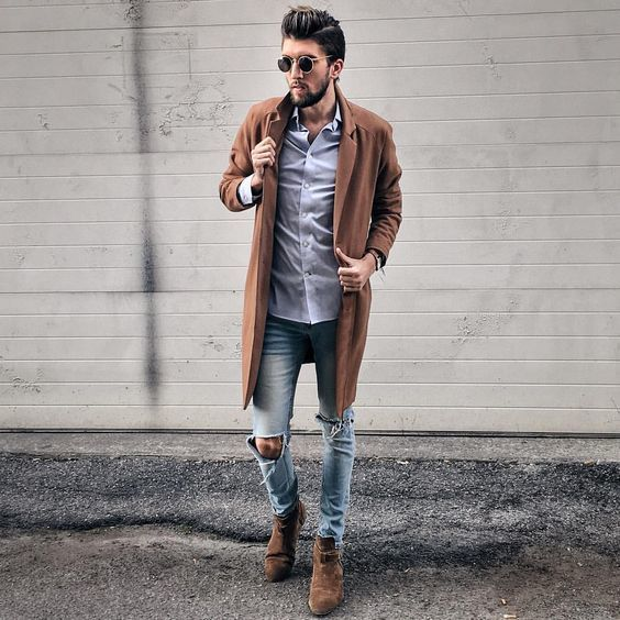 Men S Brown Overcoat Light Violet Dress Shirt Light Blue Ripped Skinny Jeans Dark Brown Suede Chelsea Boots Brown Suede Chelsea Boots Brown Chelsea Boots Outfit Mens Outfits