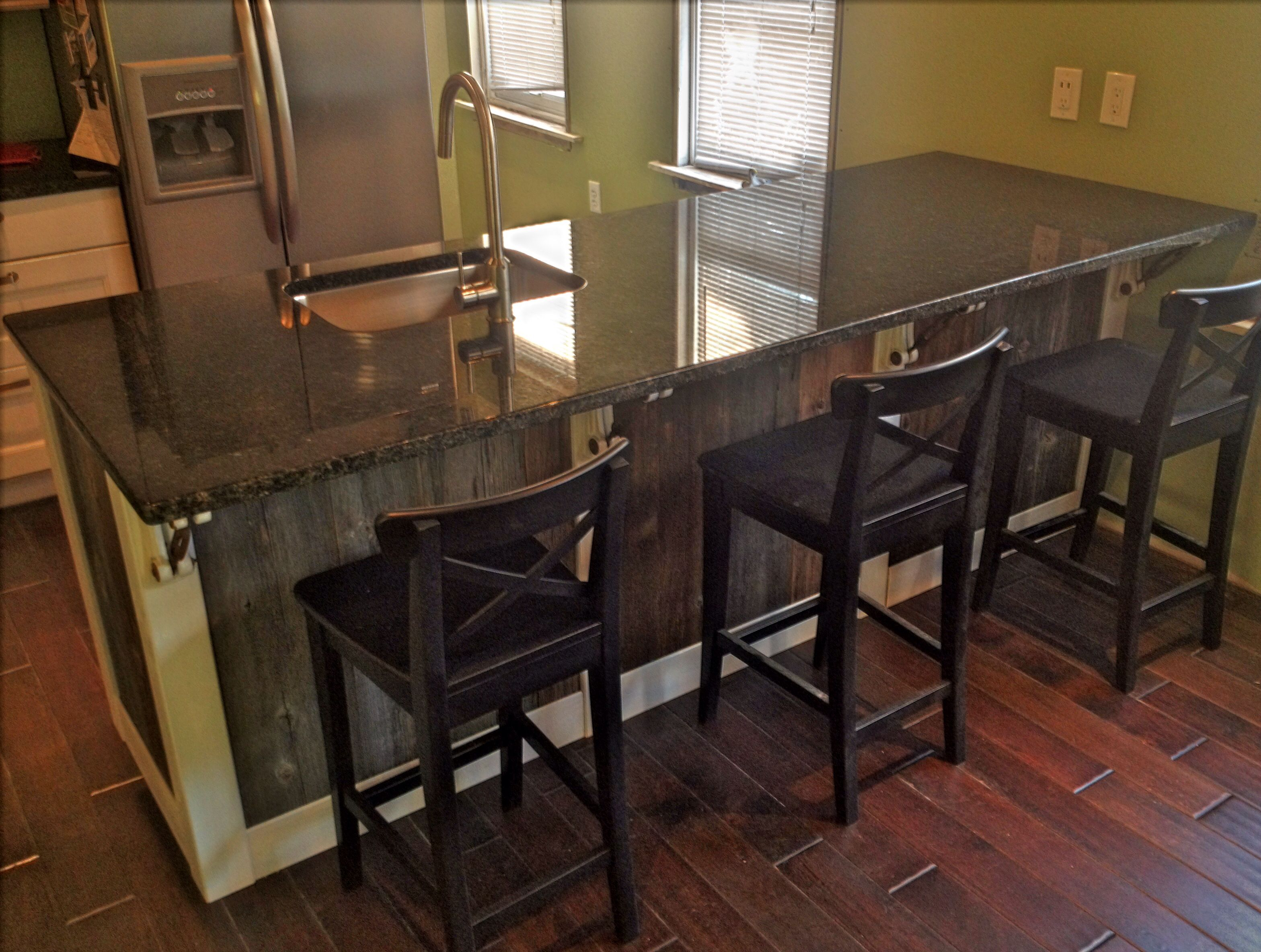 Barn wood kitchen island with IKEA cabinets and Uba Tuba granite