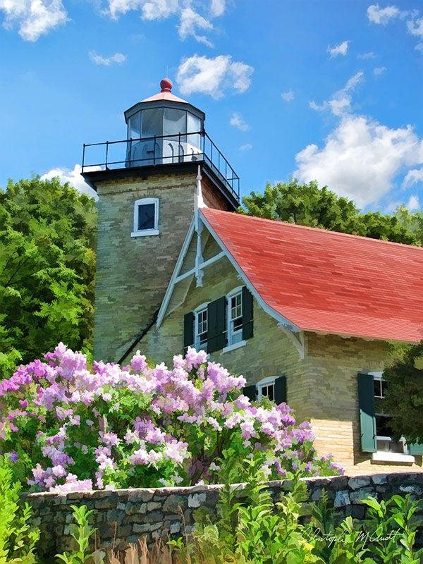 Eagle Bluff Lighthouse Lilacs Fish Creek, Wisconsin, USA – No. 108 Old world craftsmanship is seen in the details of the Eagle Bluff Lighthouse, located within Peninsula State Park near Fish Creek, WI. Guiding sailors and protecting them from the dangerous shoals along the Door County coast, the Eagle Bluff Lighthouse stands majestically among blooming lilacs above the waters of Green Bay.