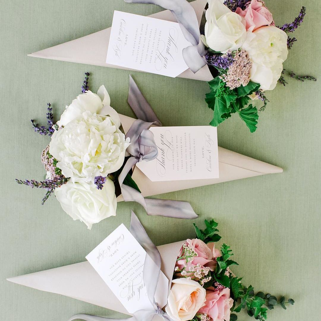 In search of wedding favor inspo this couple had a flower station in search of wedding favor inspo this couple had a flower station at their reception where guests received nosegays in paper cones to take home mightylinksfo Image collections