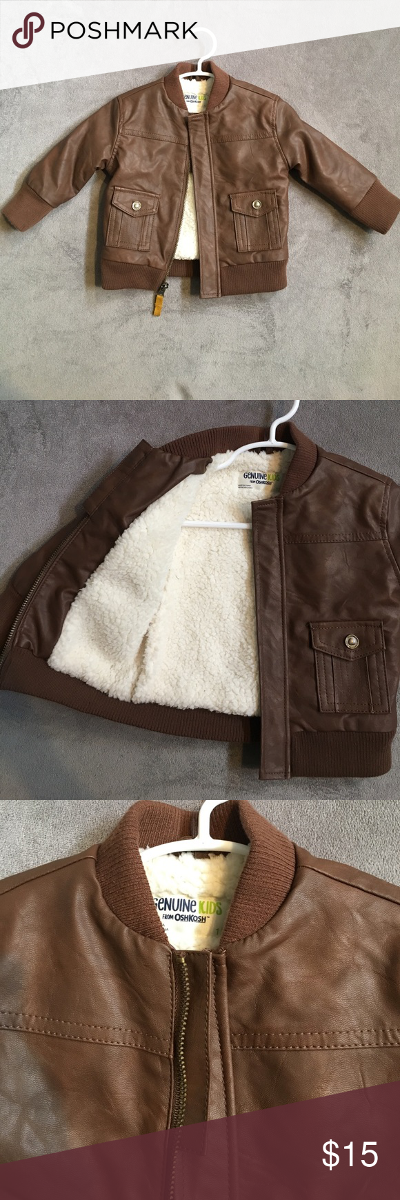 Baby boy's bomber jacket NEVER WORN! purchased for a trip up north but it was surprisingly warm out. Brown bomber jacket with fleece lining. Perfect for everyday use. Excellent condition Jackets & Coats