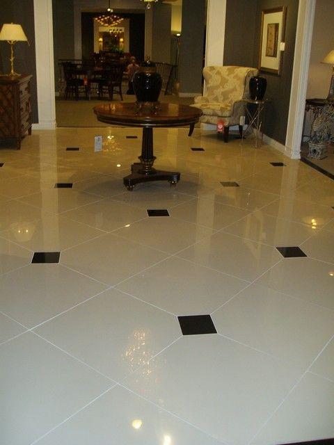 24x24 Lv Linen Porcelain With Polished Black Marble Inserts Used In Toronto S Renowned Art Shoppe Tile Floor Flooring White Tile Floor