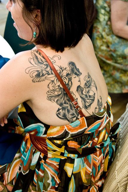 Random Wedding Guest With Lovely Mucha Tattoo by Tymcode, via Flickr