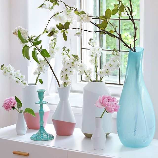 Friday flowers! #flowersoftheday #pink #blue #vases #candlestand #white #window #welovewestwing #interiorlover #getinspired #styleyourhomewithus