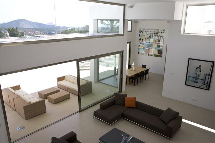Livings modernos en doble altura new casa minimalista for Sala casa minimalista
