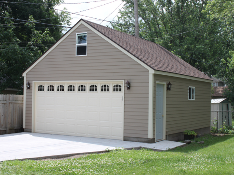 Custom two-car garage with attached workshop | Garage design ...