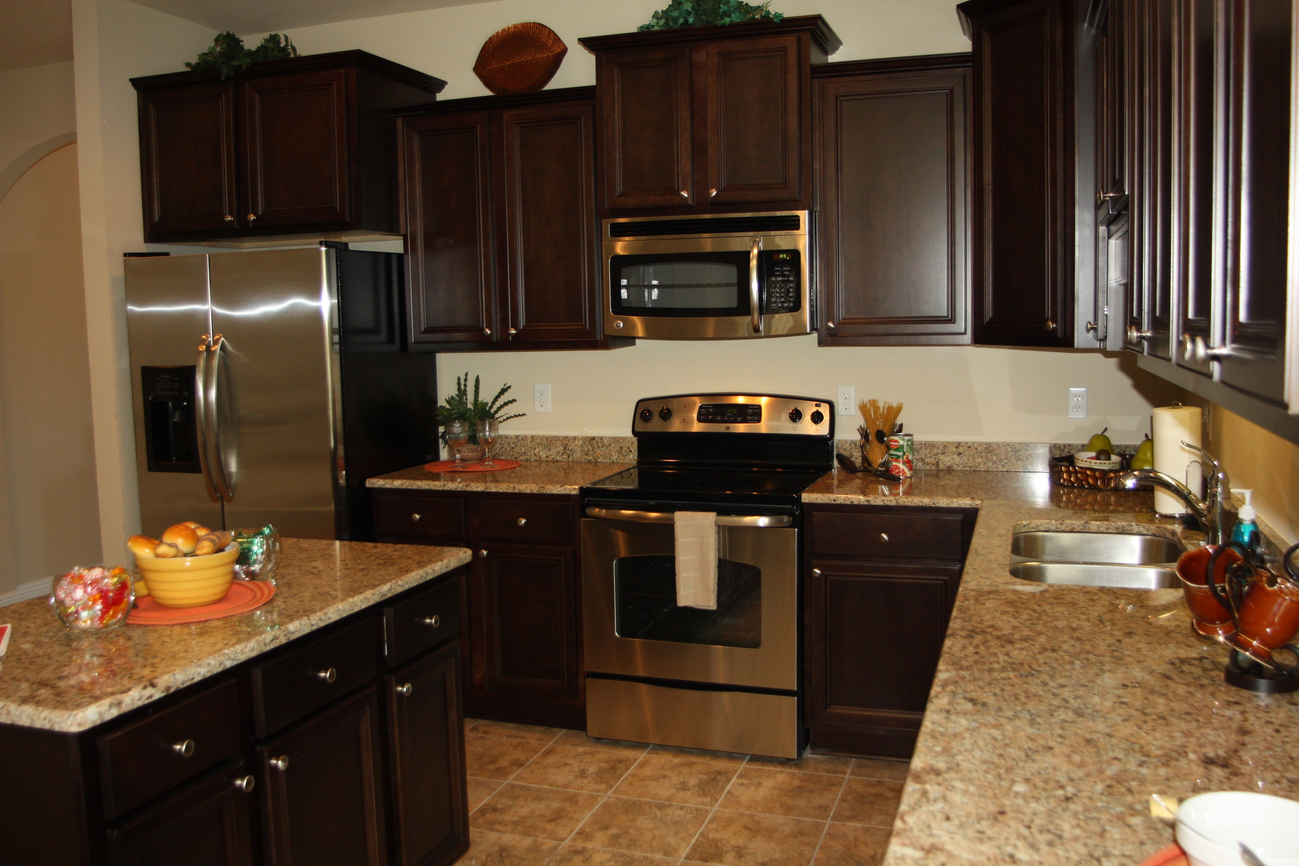 The Bailey Floor Plan S Kitchen Features Stacked Cabinets And Stainless Steel Appliances In Areas On The Gulf Coast Whe Kitchen Cabinets Kitchen Kitchen Design