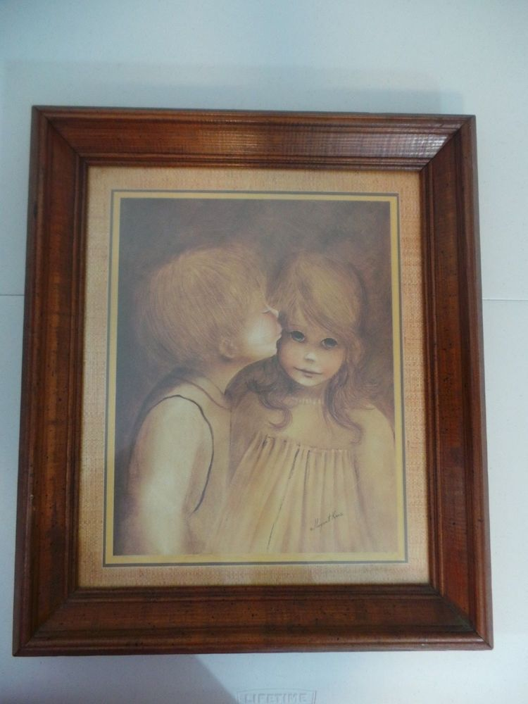 Home exteriors party circa 1970s vintage home interiors and gifts a little kiss framed art print by margaret kane