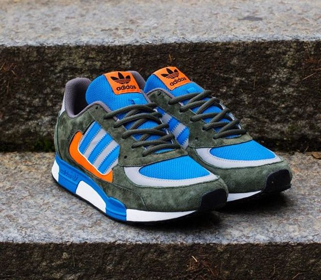Here is the latest release of the adidas ZX The runner dons a green suede  upper that is shaped with orange, grey and blue leather elements.