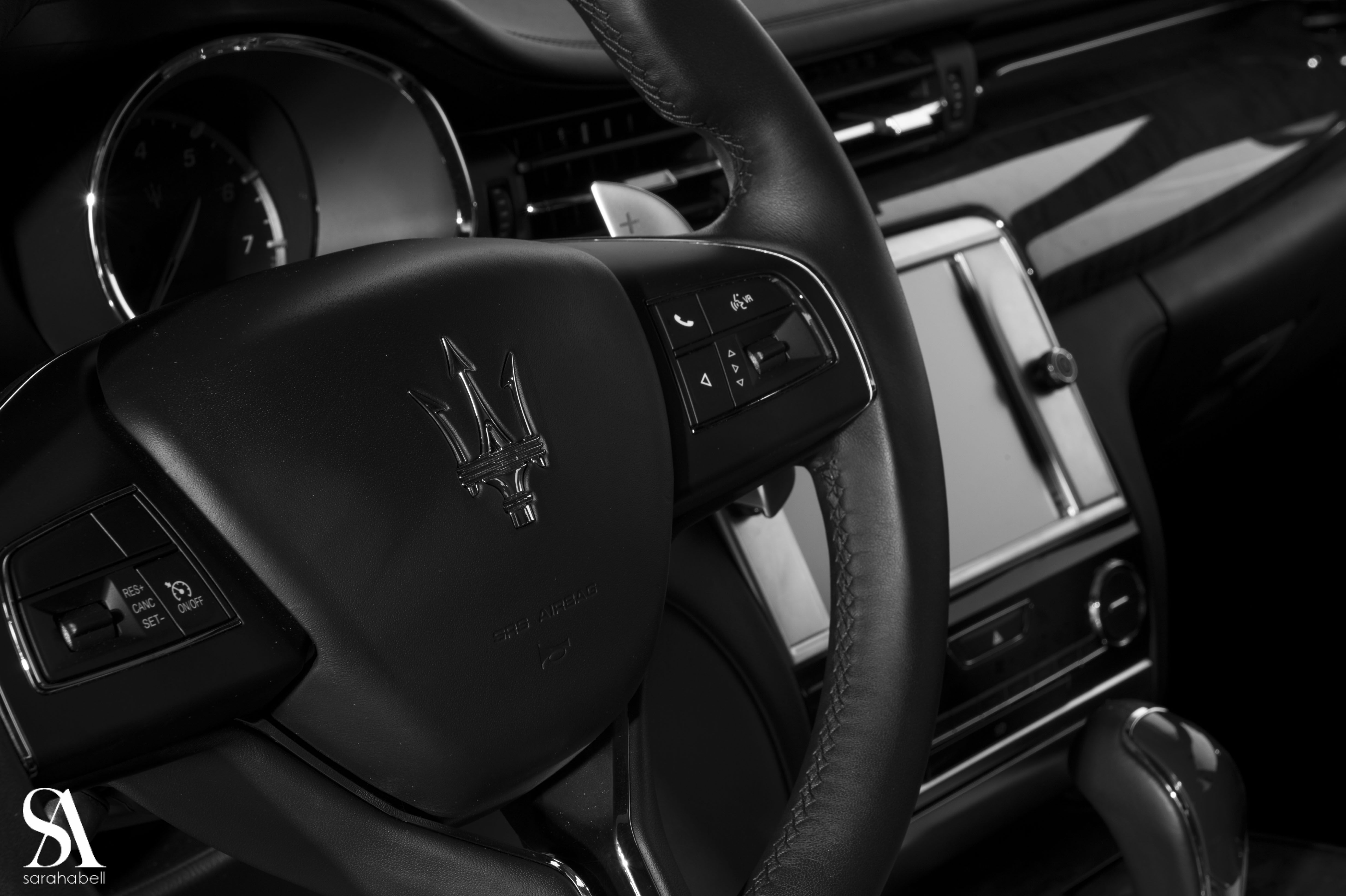 Sarah Abell With A Picture Inside A Maserati
