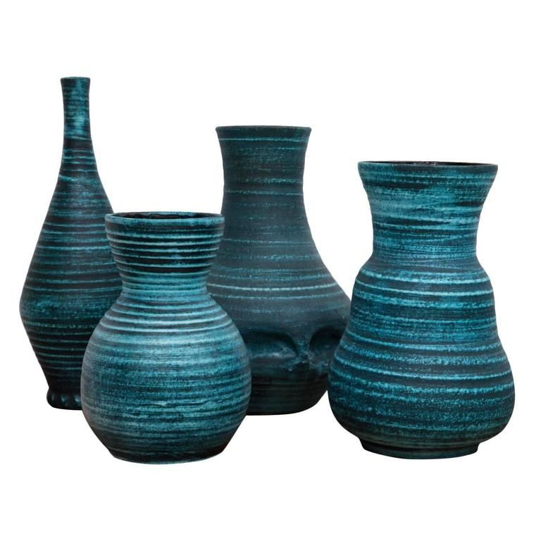 Set of four Blue Banded Ceramic Vases 'Gaulois' by Accolay, France, 1960s - Set of four blue banded 'Gauloise' ceramic vases, tapering ovoid shape with flared rim, the pale blue bands over a darker blue base with a black interior. By Accolay, France from the 1960s. All pieces are signed.