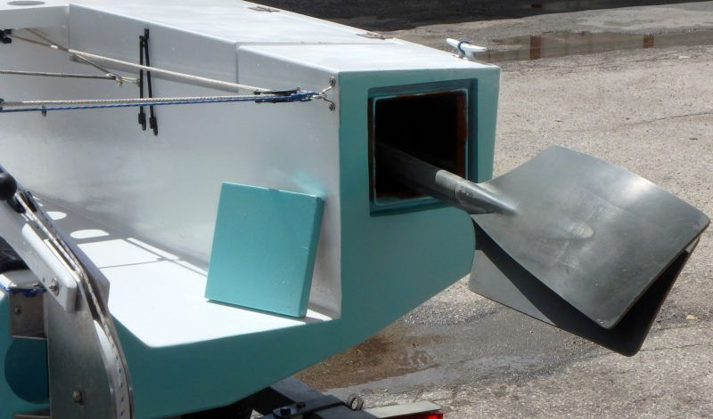 When the oars are not needed they can be stowed out of the way under the starboard deck. The cover for the access hatch is retained by an internal bungee cord.