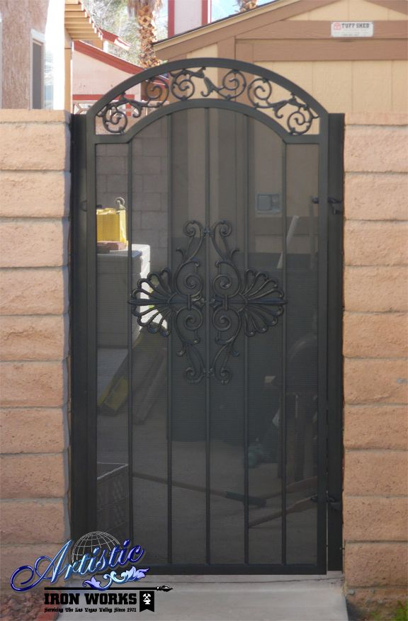 Arched wrought iron side gate with castings