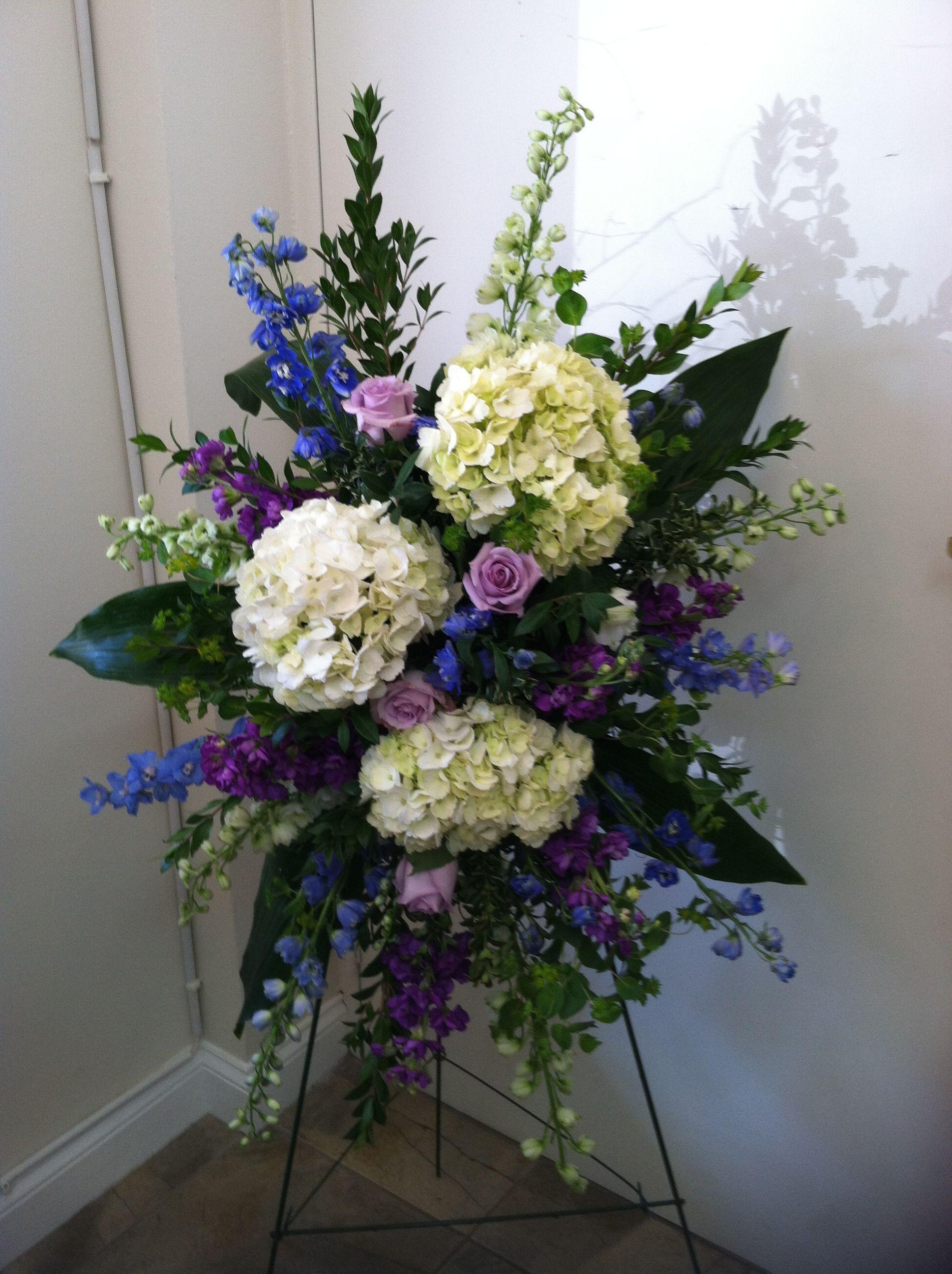 Blue White Silver Casket Spray Funeral Flowers With Hydrangeas Roses Delphinium Cowboys Inspir Casket Sprays Funeral Flower Arrangements Funeral Flowers