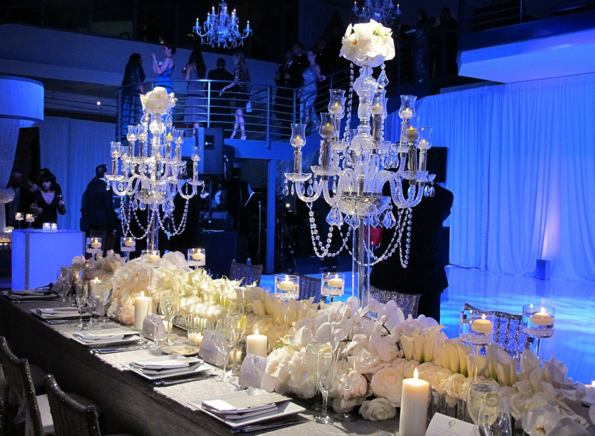 Light blue wedding decoration ideas  Wow Love these chandeliers at this blue uplighting wedding