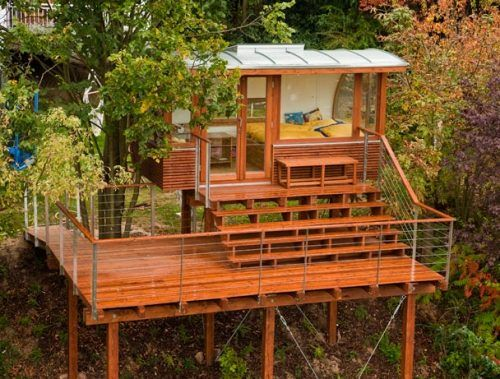 I'm guessing this tree house overlooks some kind of event space. They builders incorporated bleachers into the design.