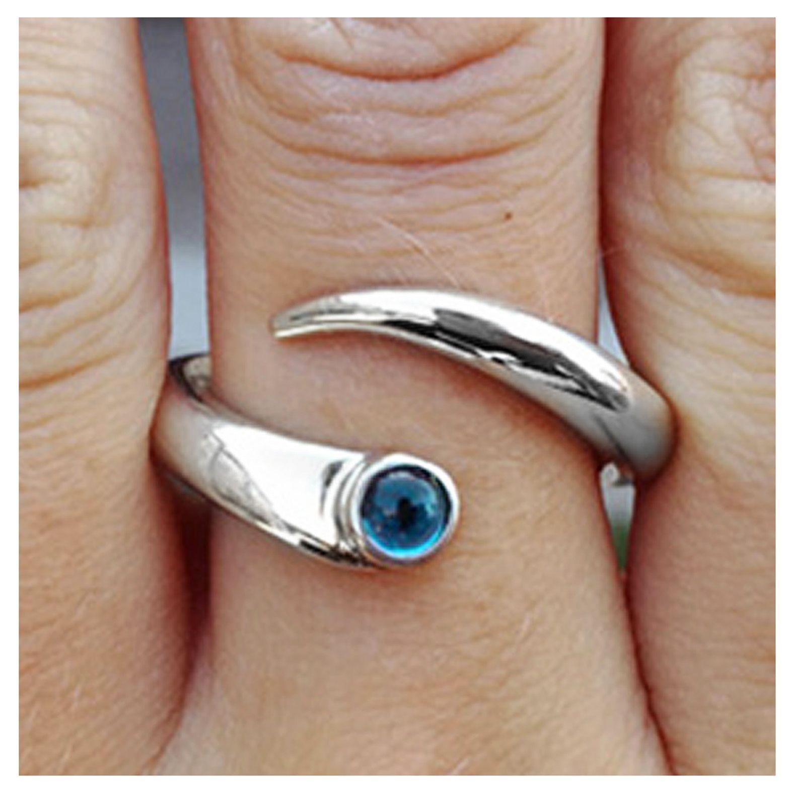 Curving silver ring with blue topaz #paulfinchjewellery #silverrings #topazrings #contemporaryjewellery #handmaderings