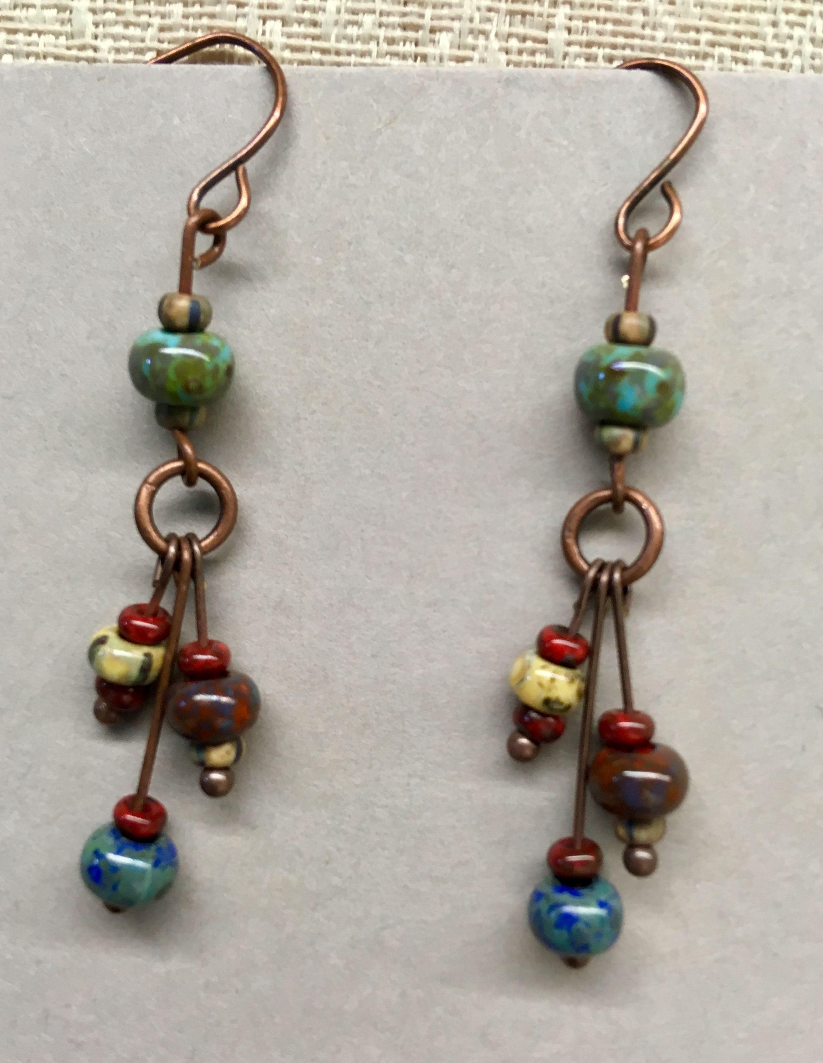 Copper dangle earrings made with Czech Picasso beads.   TAKI ...