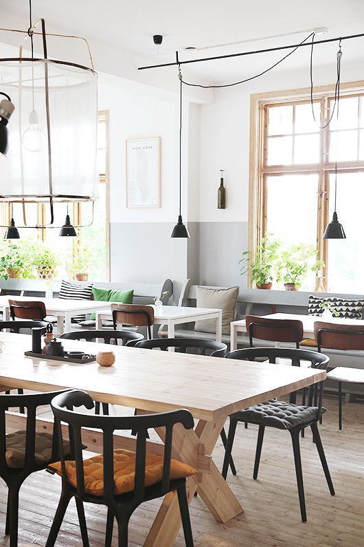 Black Ikea PS 2012 chairs and white Melltorp tables mixed