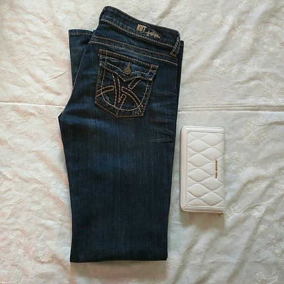 Dark Blue Low-rise Bootcut Jeans Show your style with these dark blue jeans with tan and seams. Button back pockets. Worn a few times. 34' inseams great for wearing these jeans with heels. Dress up or down with these. ?? Pants Boot Cut & Flare