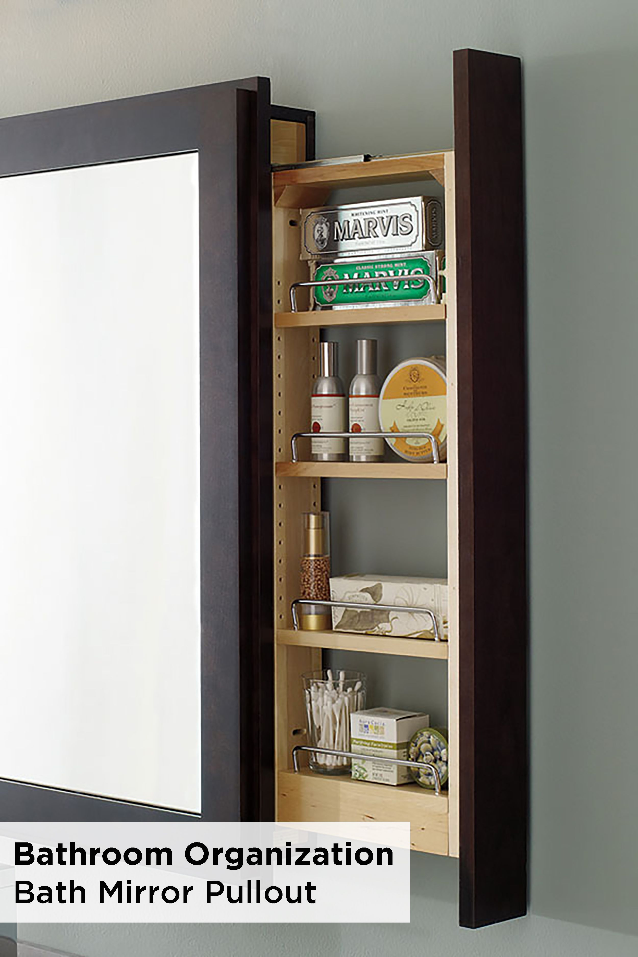 Optimize space using a Decora bath mirror with pullout shelf. This ...