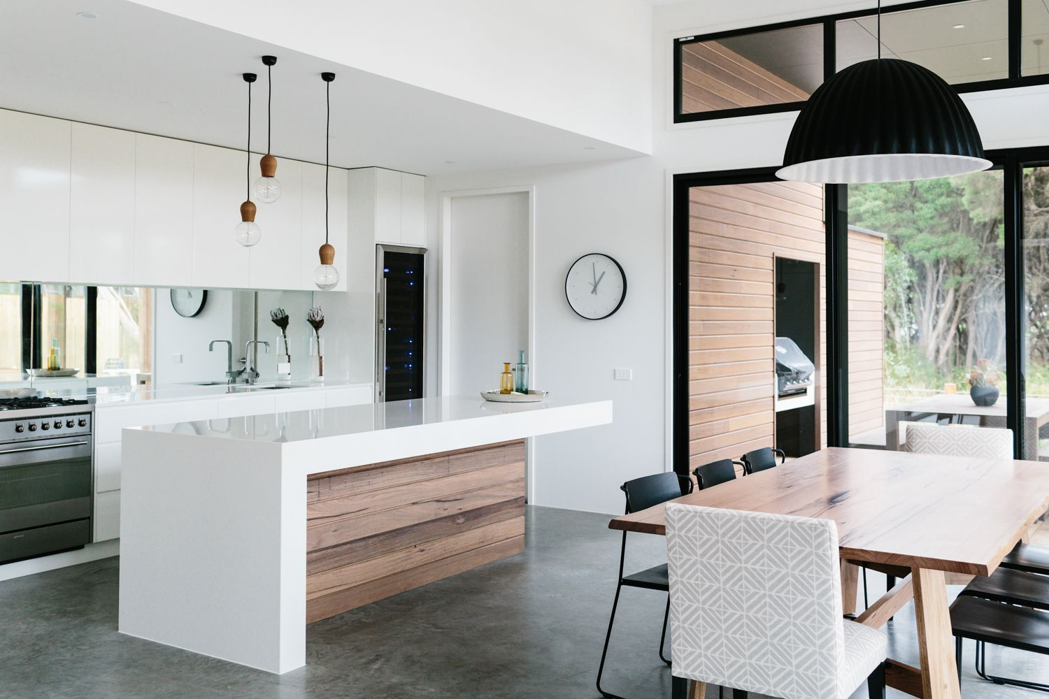 Minimalist kitchen white grey black and natural wood tones gorgeous with a scandinavian feel