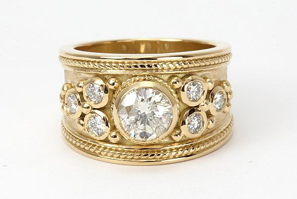 A Unique Bespoke Diamond Ring Crafted In 18ct Yellow Gold Steven Stone Wide Band Engagement Ring Diamond Rings Bands Wide Band Engagement