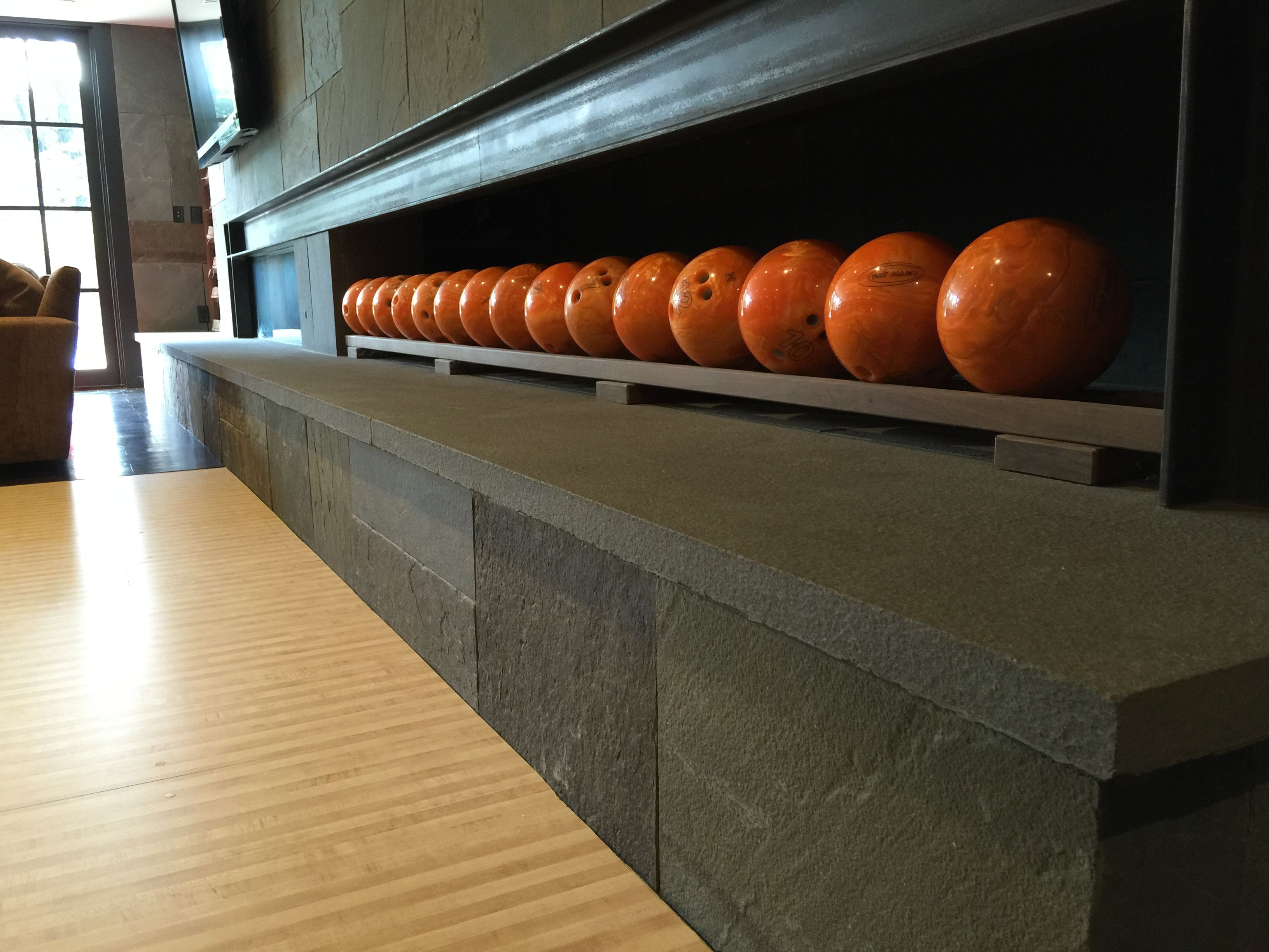Fireplace style rack for home bowling alley ball storage
