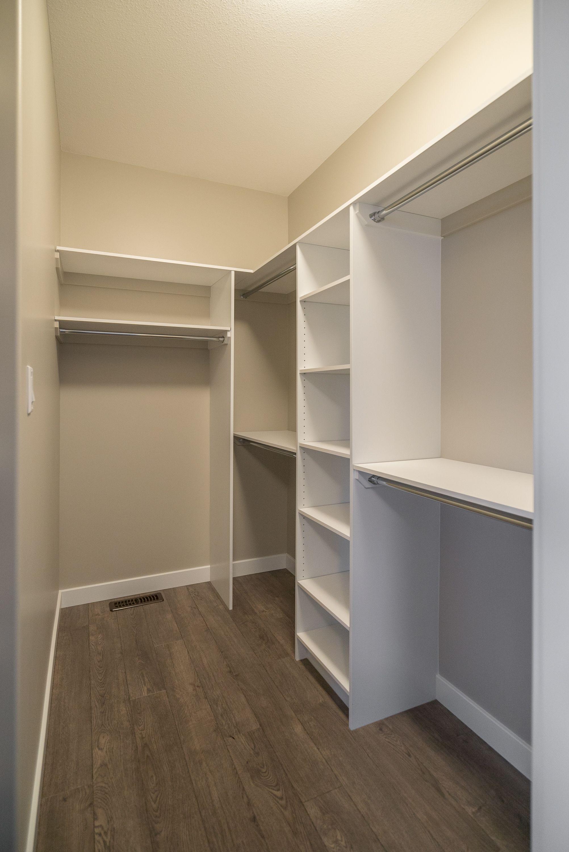 Custom walk in closet organization builtin storage