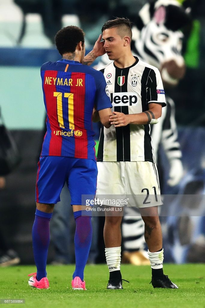 Paulo Dybala of Juventus shakes hands with Neymar of FC Barcelona at full-time following the UEFA Champions League Quarter Final first leg match between Juventus and FC Barcelona at Juventus Stadium on April 11, 2017 in Turin, Italy.