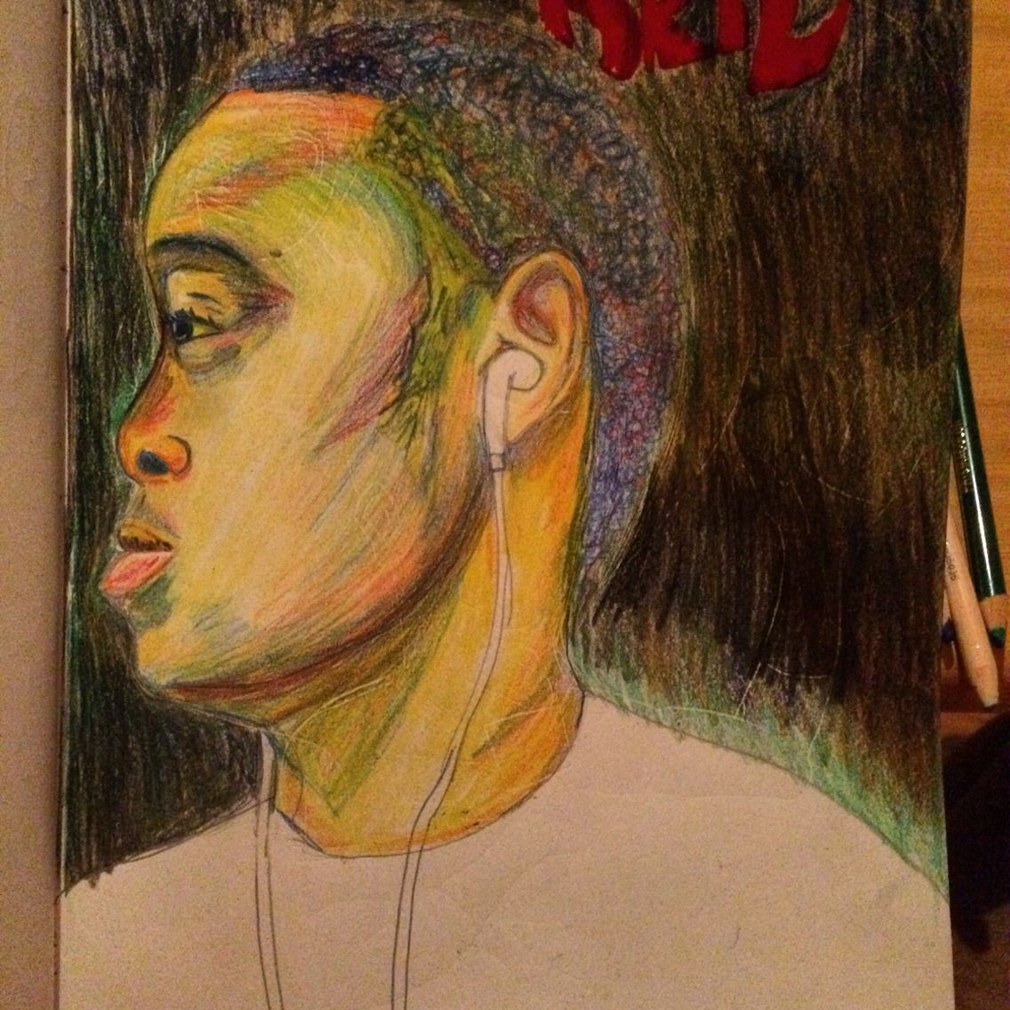 A Self Portrait I did of my self in color pencils.