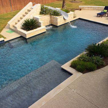 Geometric pool design with great water slide accented by built in ...