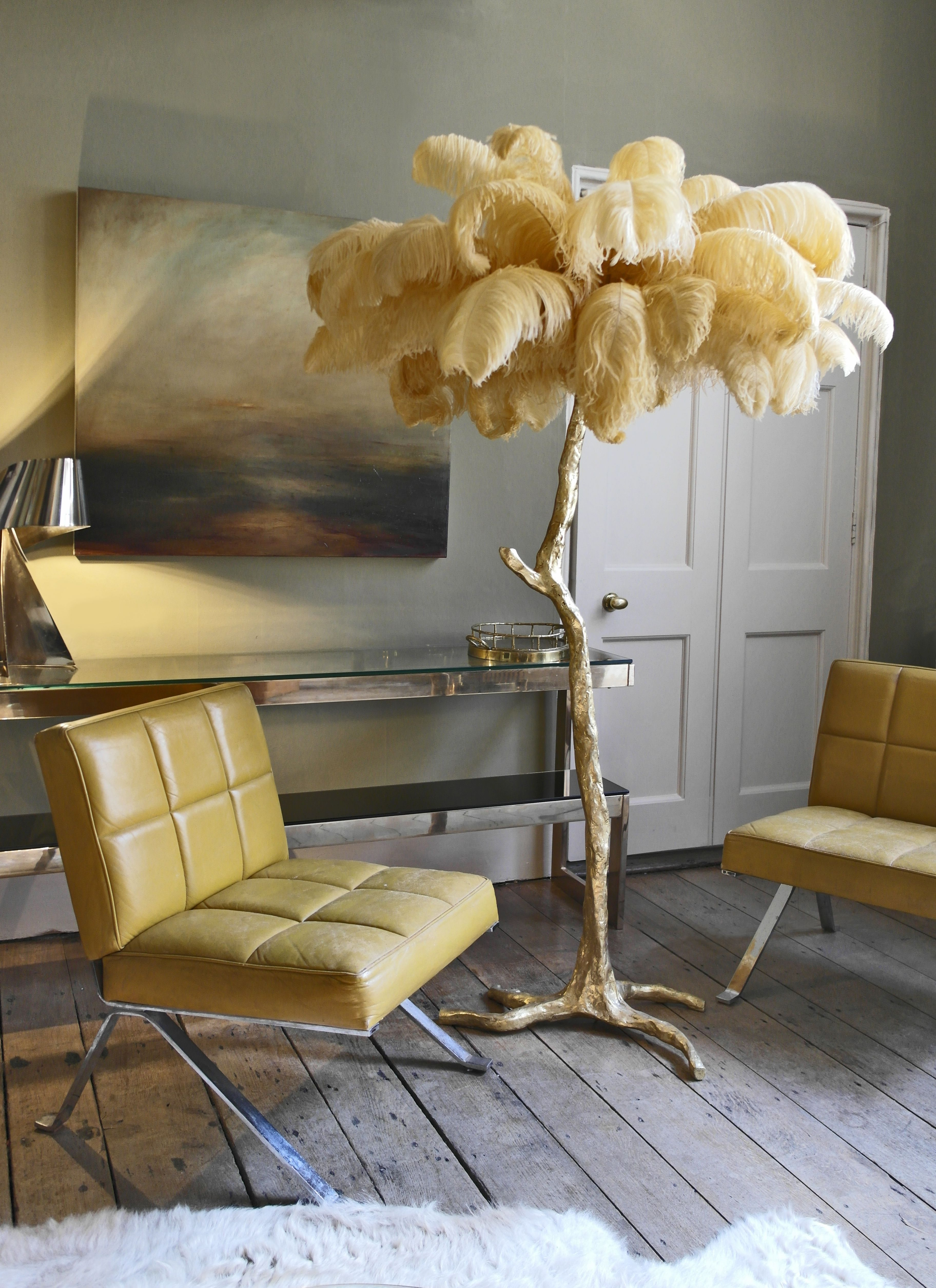 Ochre An Illuminating Palm Tree Resplendent With Exquisite Ostrich Feather Foliage Amoderngrandt Feather Decor Luxury Living Room Inspiration Feather Lamp